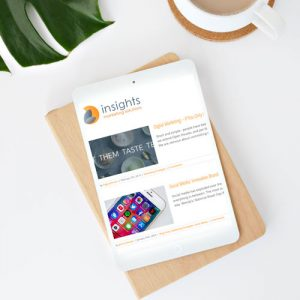 A tablet displays the blog page from Insights Marketing Solutions