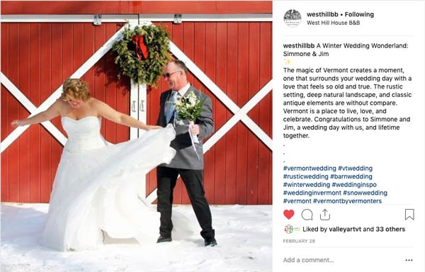 Bride and Groom stand in front of red barn in Instagram Post from West Hill House Bed and Breakfast.
